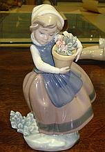 Lladro figure girl with basket of flowers
