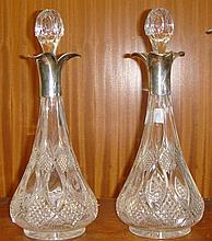 Pair of silver topped decanters Elkington & Co