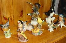 Collection of assorted bird ornaments including