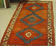 Large red ground rug with three central medallions