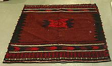 Brown ground rug with two central diamonds