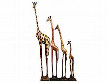 GROUP OF FOUR CARVED AND PAINTED WOOD STUDIES OF GIRAFFES