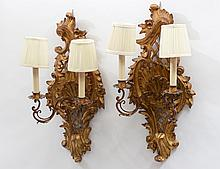 PAIR OF NEO-CLASSICAL STYLE CARVED AND GILTWOOD TWO LIGHT SCONCES