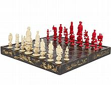 CARVED AND STAINED IVORY FIGURAL CHESS SET
