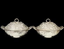 PAIR OF STERLING SILVER REPOUSSE SUPPER DISHES AND COVERS