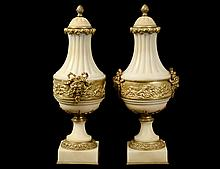 PAIR OF EMPIRE STYLE GILT BRONZE MOUNTED MARBLE CASSOLETTES