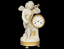 GILT BRONZE AND WHITE BISQUE CLOCK