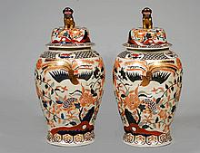 PAIR OF PORCELAIN TEMPLE JARS AND COVERS