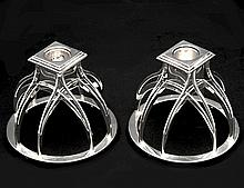 PAIR OF MID-CENTURY SILVER PLATED CANDLE HOLDERS