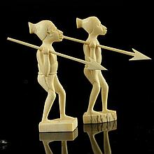 Pair of Carved African Ivory Warrior Figures.