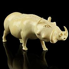 African Carved Ivory Figure of a Warthog.