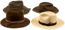 Lot of four cowboy hats.