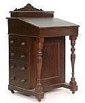 An Edwardian mahogany davenport with four drawers