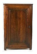 An early 19th century oak hanging corner cupboard