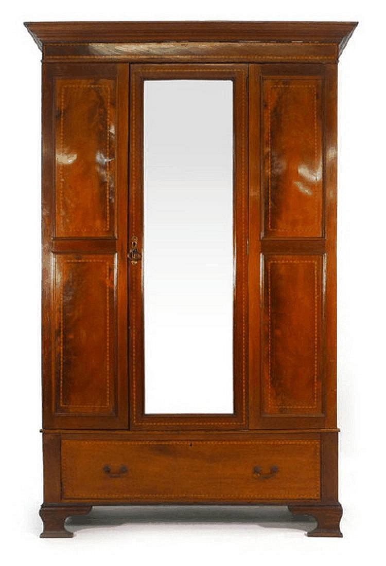 An Edwardian mahogany and strung wardrobe with