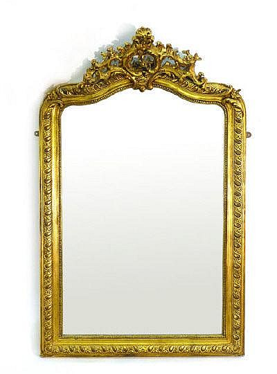 An early 20th century rococo-style wall mirror,