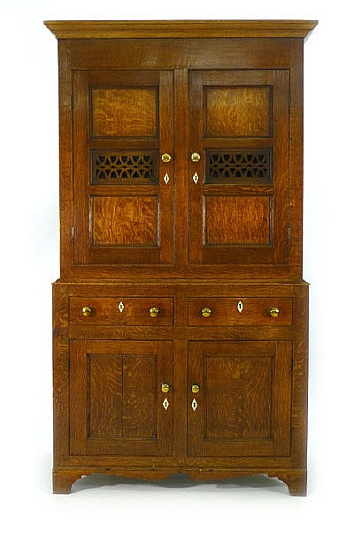 An 18th century oak and bone inlaid dole cupboard