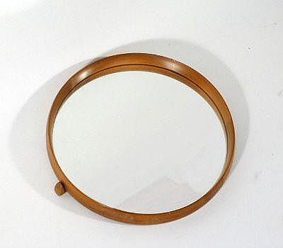 A 1970s porthole mirror, the teak circular frame