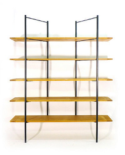 A late 20th century wall mounted shelving unit