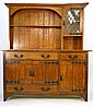 An Arts & Crafts oak and iron mounted dresser with