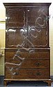 A 19th century-style mahogany linen press with