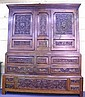 Late Victorian heavily carved oak three tier cupboard having  six drawers and  large double door cabinet over, w. 204 cm, h. 240 cm