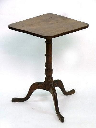 A 19th century tripod table in a variety of woods,