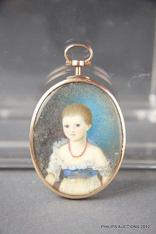 A GEORGIAN GOLD-FRAMED PAINTED MINIATURE PORTRAIT OF A YOUNG GIRL