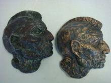 Pair of Signed Plaster Native American Plaques: