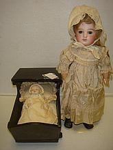 German & Japanese Bisque Dolls with Cradle: