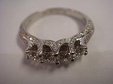 Ladies Stylized Diamond and Platinum Ring: