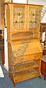 An Arts  &  Crafts style oak Bureau Bookcase 85cm