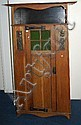 An Arts and Crafts oak wardrobe with single door,