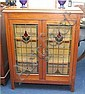 A 1920's mahogany bookcase with 'Art Nouveau'