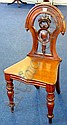 A Victorian mahogany hall chair on turned legs