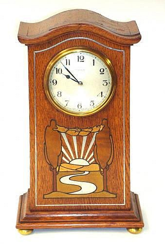 A Liberty & Co mantel clock attributed to Leonard