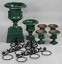 A GROUP OF GREEN PAINTED CAST IRON GARDEN URNS TOGETHER WITH A PAIR OF SCROLL FORM PAINTED CAST IRON WALL MOUNTS FOR POTS