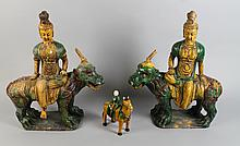 PAIR OF GUANYIN, EACH RIDING FIGURES OF BEASTS FOO FIGURES; TOGETHER WITH TANG STYLE FIGURE ON HORSE