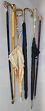 GROUP OF WALKING STICKS, UMBRELLAS AND A PARASOL