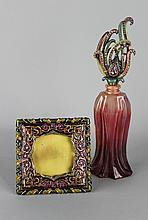 JAY STRONGWATER PERFUME BOTTLE WITH JEWELED TOP TOGETHER WITH A PERSIAN STYLE SQUARE PICTURE FRAME WITH CARTOUCHE