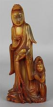 CHINESE HORN FIGURE OF GUANYIN AND A CHILD