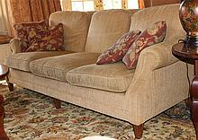 THREE-SEAT BEIGE UPHOLSTERED SOFA