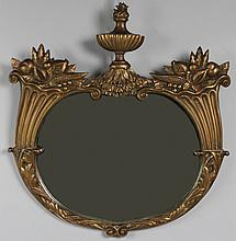 NEOCLASSICAL STYLE CARVED GILTWOOD OVAL MIRROR
