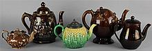 FOUR BROWN-GLAZED POTS AND ONE CAULIFLOWER TEAPOT AND COVER