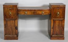 ENGLISH REGENCY CARVED AND INLAID MAHOGANY PEDESTAL SIDEBOARD, CIRCA 1815