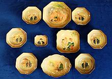 A collection of embossed Royal Doulton Dickens seriesware to include Sam Weller Fruit dish together with 6 Peggarty fruit dishes, Dolly Varton square plate, Little Nell dish, Captain Cuttle Dish etc (10) (3 of Peggarty dishes have small chips to