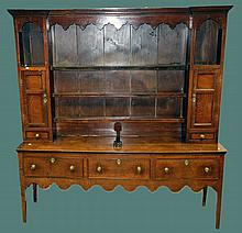 Georgian Oak welsh dresser, three draw base on tapered legs with plate rack with two cupboard and shaped top rack, width 193cm x depth 46cm x height 204cm