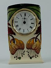 Moorcroft clock decorated in the Anna Lily design, height 15cm