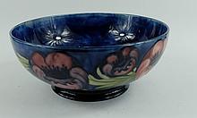 William Moorcroft footed fruitbowl decorated in the big poppy design, diameter 23cm