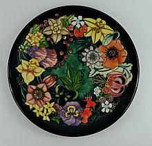 Moorcroft large charger decorated in the Carousel design signed Racheal Bishop and dated 1996, diameter 35cm in original box